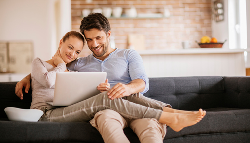 Couple watches movie on laptop: NFLX, IBM Q3 earnings