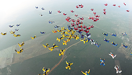 Image of a large group of people parachuting