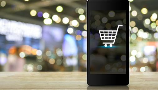 Smartphone with an e-commerce shopping basket on the screen