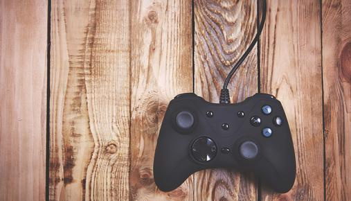 Video game controller on top of wood boards
