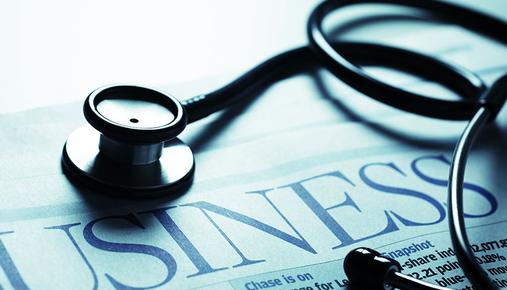Black stethoscope on newspaper