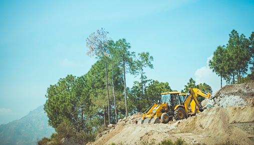 Caterpillar bulldozer on top of a hill