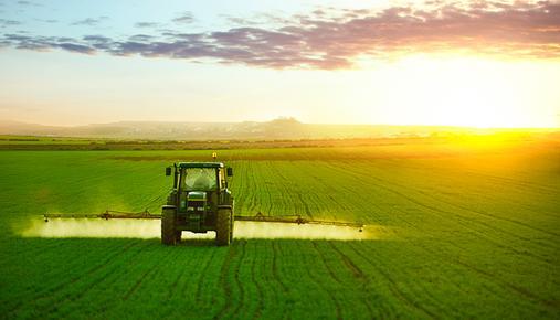 Deere tractor working on farm