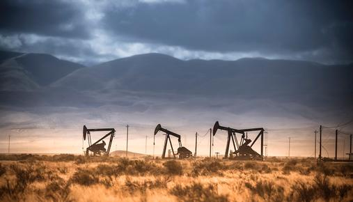 Oil pumps working in front of mountains