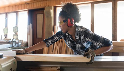 Woman working in carpenter workshop