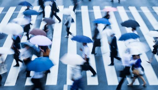 People Walking With Umbrellas: Investment strategies to help weather rising interest rates