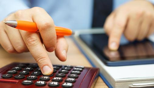 Man Calculating Inflation's Impact on Bonds