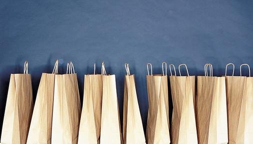 A row of brown paper shopping bags