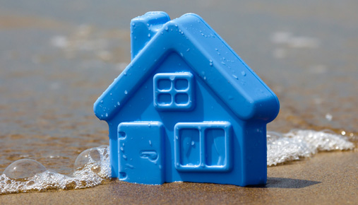 House on sand: Try to think concrete when planning your investment goals, versus intangible numbers