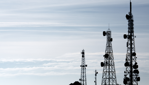 Telecommunications towers at dusk