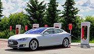 Does Tesla's Upbeat Revenue Guess, Product Spin Conflict?